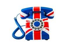 Union Jack-Telefon mit dem Muster von Großbritannien-Flagge lokalisiert auf weißem Hintergrund Lizenzfreie Stockfotografie