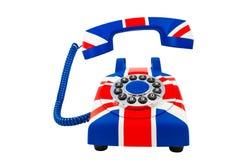 Union Jack-Telefon mit dem sich hin- und herbewegenden Hörer mit dem Muster von Großbritannien-Flagge lokalisiert auf weißem Hint Lizenzfreie Stockbilder