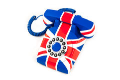 Union Jack telephone with pattern of Great Britain flag isolated on white background Royalty Free Stock Photo