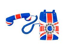 Union Jack telephone with the receiver off the hook laying in front of the phone isolated on the white background. Union Jack telephone with pattern of British Stock Photo