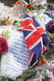 Union Jack and tributes to victims of the London Bridge terroris. London, UK - 7 June 2017: Floral tributes and a Union Jack laid as a memorial to the victims of Stock Images