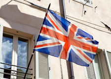 Union Jack. Is waving in the wind. The  is the national flag of the United Kingdom stock images