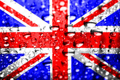 Union Jack Texture With a Wet Look. UK flag texture covered in rain drops Stock Photos