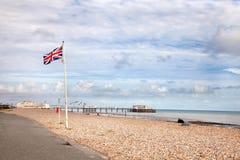 Union Jack on Worthing beach. Union Jack flying at the sea front near the Worthing pier Stock Image