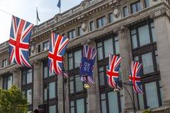 Union Jacks hanging over Oxford street Royalty Free Stock Photo