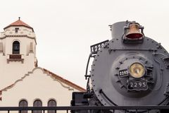 Union Pacific antique engine number 2295 Big Mike. On display at the Boise Depot. Boise Depot bell tower in the background stock photo
