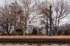 Union Pacific, Boise elevation marker. Sign is located at the Boise depot. Elevation is 2753. Bare trees in the background with RR tracks in the foreground Royalty Free Stock Photography
