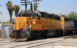 Union Pacific train in Los Angeles County, CA. Union Pacific train with engineer in Los Angeles County.  June 17th, 2010 - This company's shares have been named Royalty Free Stock Image