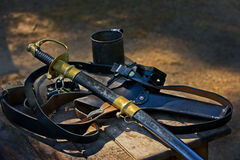Union solder weapons. American Civil War Officers weapons layed on the table next to his tin coffee cup out in the field Royalty Free Stock Photography
