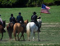 Union soldiers ready to fight. Union soldiers on horse back are preparing to fight on horse back, during a Reenactment from the 2012 Jackson Michigan Civil war Stock Images