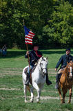 Union soldiers ready to ride. Union soldiers on horse back are preparing to ride on horse back, during a Reenactment from the 2012 Jackson Michigan Civil war Stock Image
