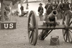 Union Soldiers - Sepia. United States Civil War Union soldiers in background with canon and ammo box forefront - reinactment scene Royalty Free Stock Image