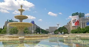 Union Square Fountain And House Of The People Or Parliament In Bucharest. BUCHAREST, ROMANIA - JUNE 15, 2016: Union Square Fountain And House Of The People Or stock video footage
