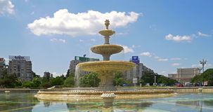 Union Square Fountain And House Of The People Or Parliament In Bucharest. BUCHAREST, ROMANIA - JUNE 15, 2016: Union Square Fountain And House Of The People Or stock footage