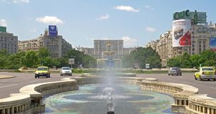 Union Square Fountain And House Of The People Or Parliament In Bucharest. BUCHAREST, ROMANIA - JUNE 15, 2016: Union Square Fountain And House Of The People Or stock video