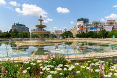 Union Square Fountain And House Of The People Or Parliament Palace In Bucharest. BUCHAREST, ROMANIA - MAY 28, 2016: Union Square Fountain And House Of The People stock photography