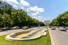 Union Square Fountain And House Of The People Or Parliament Palace In Bucharest. BUCHAREST, ROMANIA - MAY 28, 2016: Union Square Fountain And House Of The People royalty free stock photography