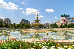 Union Square Fountain And House Of The People Or Parliament Palace In Bucharest. BUCHAREST, ROMANIA - MAY 28, 2016: Union Square Fountain And House Of The People stock image