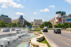 Union Square Fountain And House Of The People Or Parliament Palace In Bucharest. BUCHAREST, ROMANIA - MAY 28, 2016: Union Square Fountain And House Of The People stock photos