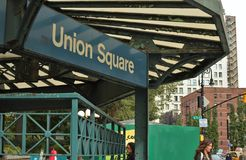 Union Square NYC Sign New York City People Street Trendy Busy Manhattan royalty free stock image