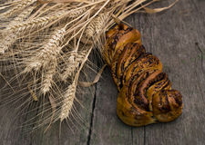 Union of stalks of wheat and roll with poppy Stock Photography