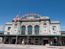 Union Station. Denver, Colorado-April 9, 2011: Union Station in Denver, Colorado. The station building on sending trains. in front of the building is the US flag Royalty Free Stock Images