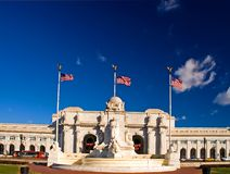 Union Station - Washington DC. Blue sky over the entrance to the Union Station in Washington, DC. This is a major Amtrak rail station. A statue dedicated to royalty free stock images