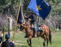 Union Wins the Flag. Red Bluff, California, United States-April 25, 2015: A Union officer holds a rebel battle flag after a victory during a Civil War Royalty Free Stock Photos