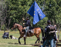 Union Wins the Flag. Red Bluff, California, United States-April 25, 2015: A Union officer holds a rebel battle flag after a victory during a Civil War Stock Photography