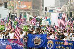 Union worker banners in front of hundreds of thousands of immigrants participating in march for Immigrants and Mexicans protesting Royalty Free Stock Photos