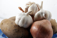 Unions, garlic and potatoes. On isolated white background Stock Photos