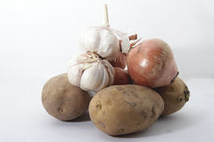 Unions, garlic and potatoes. On isolated white background Stock Image