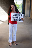 Unions Make us Strong. Female supporter holding sign that says Unions Make us Strong at a rally at the Hawaii State Capitol in downtown Honolulu on February 26 Stock Photo