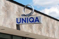 Uniqa ubezpieczenia grupy AG firmy logo na gałęziastym budynku Fotografia Stock