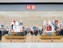 Uniqlo Co.,有限公司是日本便衣设计师、制造者和零售商 位于北京的中心商务区的心脏,包括旅馆,办公室,公寓,展览室和商城的CWTC,是在北京和其中一根据的许多跨国公司的第一个选择最大的高级商业混杂用途发展中在世界上 是日本便衣设计师,制造 图库摄影