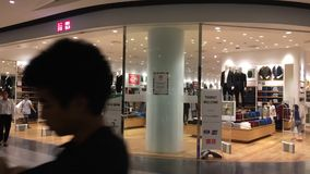 Uniqlo store. Uniqlo Co., Ltd. CHIANGMAI, THAILAND -OCTOBER 21 2016: Uniqlo store. Uniqlo Co., Ltd. is a Japanese casual wear designer, manufacturer and stock video footage