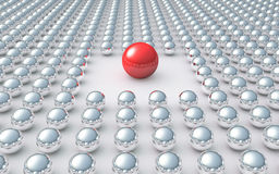 Unique. Red ball amongst many chrome balls Royalty Free Stock Photos