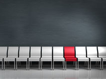 Unique. Conceptual render showing a row of chairs with one being different Royalty Free Stock Image