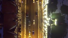 Unique Aerial Night Vladivostok Russia city Road traffic cars Svetlanskaya  main street  Illumination. People walk. Winter frozen. Snow ice roof GUM. Drone stock video footage