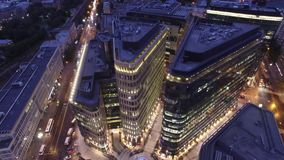 White square modern business center. Moscow Russia. Night illumination.  Office windows. Steel and glass reflections. Unique aerial shot. Best night drone stock footage
