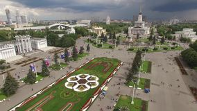 Park VDNKH in Moscow from above. Central walk and fountains. Happy people. Unique aerial view. Best weather stock video