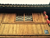 The unique architectural style of China`s ethnic minorities. The whole house is wooden structure warm in winter and cool in summer royalty free stock photography