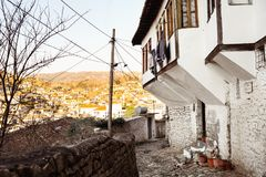 Unique architecture of Berat. Berat, historic city in the south of Albania, during a sunny day. Tiny stone streets with white stone houses built on a high hill Royalty Free Stock Image