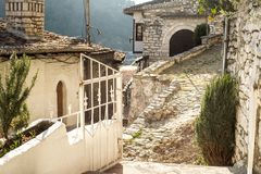 Unique architecture of Berat. View to Berat, historic city in the south of Albania, during a sunny day. Tiny stone streets and white houses built on a high hill Royalty Free Stock Photo