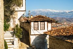 Unique architecture of Berat. View to Berat, historic city in the south of Albania, during a sunny day. Tiny stone streets and white houses built on a high hill Royalty Free Stock Photos
