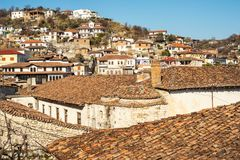 Unique architecture of Berat. View to Berat, historic city in the south of Albania, during a sunny day. Tiny stone streets and white houses built on a high hill Stock Photos