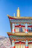 Unique architecture in the colorful windows of tibetan style on red wall.  Royalty Free Stock Image