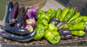 Unique assortment of peppers and egg plant Stock Photos