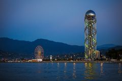 The unique attraction of Batumi is the alphabet tower. The unique attraction of Bai is the alphabet tower. Spiral metal tower with Georgian letters in the stock photo