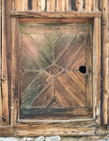 Unique barn door. Symmetrical pattern in old barn door Royalty Free Stock Photography